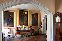 Victorian portraits of two gentlemen and a lady in the staircase hall