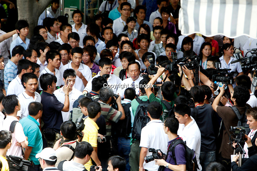 Terry Gou, founder and chairman of Hon Hai Group, center, is surrounded by the media at the company's Foxconn plant in Shenzhen, China, on Wednesday, May 26, 2010. Hon Hai is the parts supplier for many hi-tech companies around the world including Apple Inc., Hewlett-Packard Co. and Dell Inc. There have been 12 suicides at the company's 300 thousand employee strong factory complex in Shenzhen so far this year.