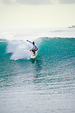 INDONESIA, Mentawai Islands, Kandui Resort, man surfing a wave called Beng Beng