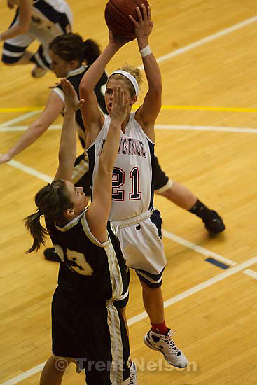 Taylorsville - Springville's Ashley Kroneberger (21) shoots over Roy's Krystin Jachim (23). Springville vs. Roy High School girls basketball, 4A State Basketball Tournament Wednesday February 25, 2009 at Salt Lake Community College.