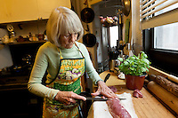 Book editor and author Judith Jones prepares a meal for herself in her apartment in New York City, USA, 2 October 2009.
