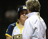 Michigan Wolverines Softball catcher Lauren Sweet (25) talks to coach Carol Hutchins during a game against the University of South Florida Bulls on February 8, 2014 at the USF Softball Stadium in Tampa, Florida.  Michigan defeated USF 3-2.  (Copyright Mike Janes Photography)