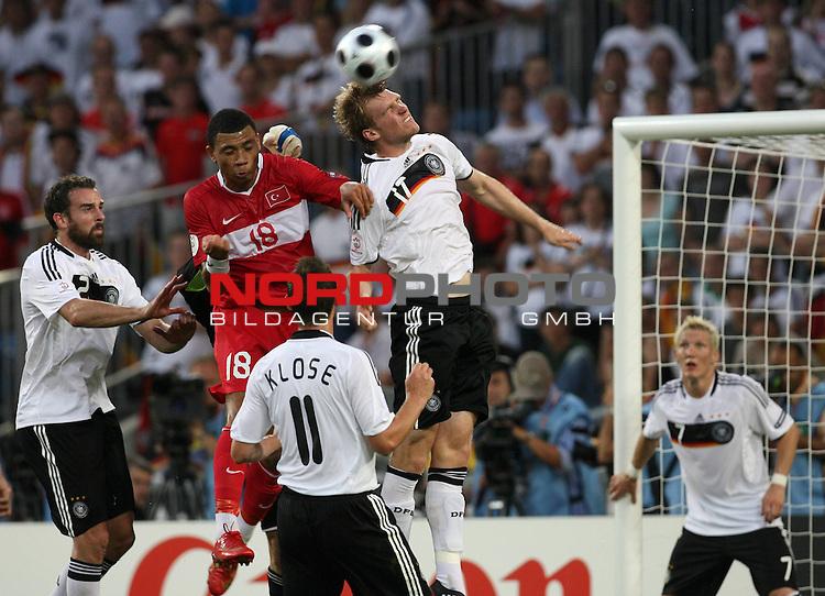 UEFA Euro 2008 Semi-Finals Match 29 Basel - St. Jakob-Park. Deutschland ( GER ) - T&uuml;rkei ( TUR ). <br /> Per Mertesacker ( Germany / Verteidiger / Defender / Werder Bremen #17 ) (M) beim Kopfball-Zweikampf mit Colin KČzim-Richards ( T&uuml;rkei / Mittelfeldspieler / Midfielder / Fenerbahće SK Istanbul #18 ) (M links).<br /> Foto &copy; nph (  nordphoto  )