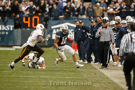 Trent Nelson  |  The Salt Lake Tribune.BYU running back JJ Di Luigi (10) is chased out of bounds by Wyoming's Tashaun Gipson (4) and Chris Prosinski (24) in the second quarter, BYU vs. Wyoming, college football Saturday, October 23, 2010 at LaVell Edwards Stadium in Provo.