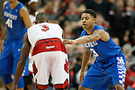 Guard Tyler Ulis of the Kentucky Wildcats guards a defender during the game against  the Louisville Cardinals at KFC Yum! Center on Saturday, December 27, 2014 in Louisville `, Ky. Kentucky leads Louisville 22-18 at halftime. Photo by Michael Reaves | Staff
