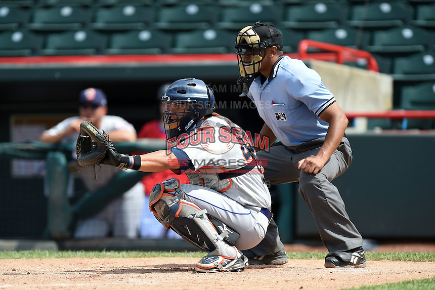 Binghamton Mets catcher Xorge Carrillo (44) and umpire Jeremie Rehak during a game against the Erie Seawolves on July 13, 2014 at Jerry Uht Park in Erie, Pennsylvania.  Binghamton defeated Erie 5-4.  (Mike Janes/Four Seam Images)