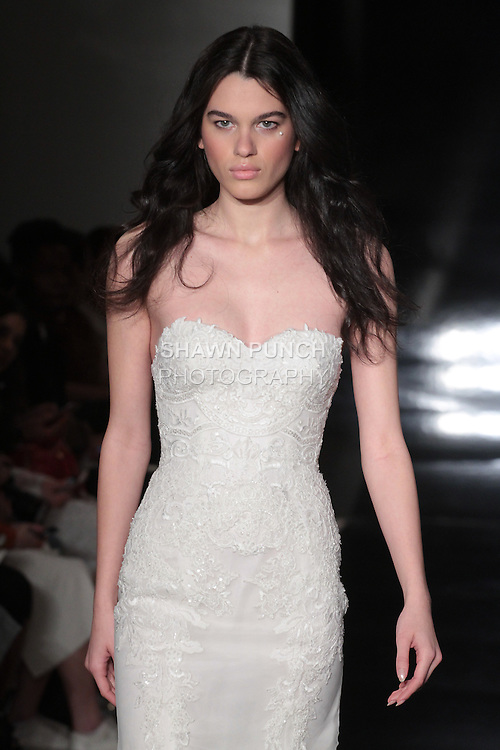 Model walks runway in a silk organza fit and flare embroidered sweetheart gown, from the Reem Acra Spring 2017 bridal collection, during New York Bridal Fashion Week Spring Summer 2017, on April 15, 2016.