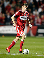 Chicago Fire forward Brian McBride (20) dribbles down the field.  Real Salt Lake defeated the Chicago Fire in a penalty kick shootout 0-0 (5-4 PK) in the Eastern Conference Final at Toyota Park in Bridgeview, IL on November 14, 2009.