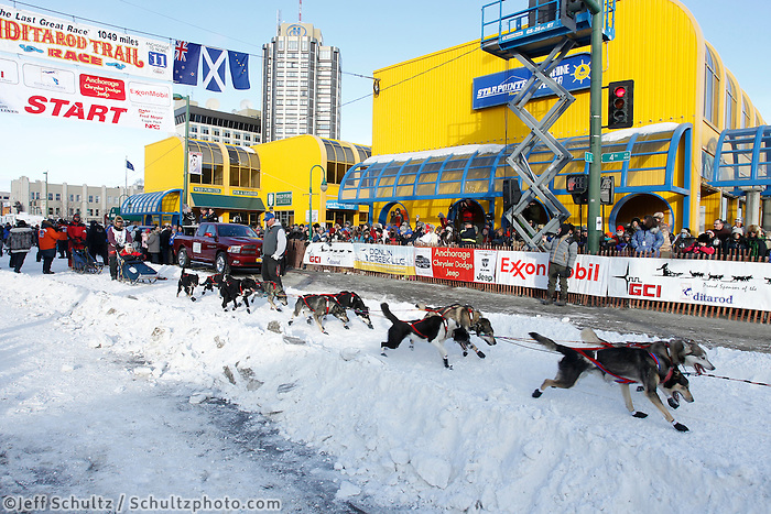 Robert Bundtzen leaves the starting line on 4th avenue in downtown Anchorage, Alaska during the ceremonial start of the 2011 Iditarod