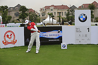 Wen-Chong Liang (CHN) on the 1st tee during Wednesday's Pro-Am Day of the 2014 BMW Masters held at Lake Malaren, Shanghai, China 29th October 2014.<br /> Picture: Eoin Clarke www.golffile.ie