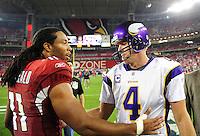 Dec 6, 2009; Glendale, AZ, USA; Arizona Cardinals wide receiver Larry Fitzgerald (left) greets Minnesota Vikings quarterback Brett Favre following the game at University of Phoenix Stadium. The Cardinals defeated the Vikings 30-17. Mandatory Credit: Mark J. Rebilas-