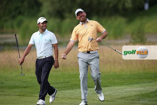 Thomas Bjorn (DEN) and Pablo Larrazabal (ESP) have a Ari Gold moment during Round Two of the BMW International Open 2014 from Golf Club Gut Lärchenhof, Pulheim, Köln, Germany. Picture:  David Lloyd / www.golffile.ie