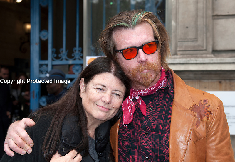 November 13 2017, PARIS FRANCE<br /> the President of France Emmanuel Macron<br /> honors the victims of the 13 november 2015<br /> in the scenes of attacks. Jesse Hughes leaves the Town Hall. He comforts a woman. # HOMMAGE AUX VICTIMES DES ATTENTATS DU 13 NOVEMBRE 2015