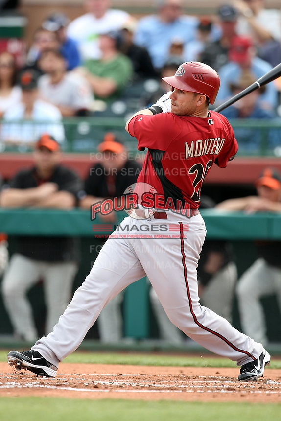 Miguel Montero #26 of the Arizona Diamondbacks bats against the San Francisco Giants in the first spring training game of the season at Scottsdale Stadium on February 25, 2011  in Scottsdale, Arizona. .Photo by:  Bill Mitchell/Four Seam Images.