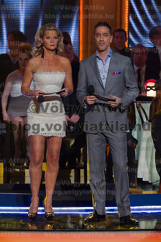 "Ildiko Kovalcsik ""Lilu"" and Andras Csonka ""Pici"" hosts of the live broadcast celebrity dancing talent show Saturday Night Fever by Hungarian television company RTL II in Budapest, Hungary on March 16, 2013. ATTILA VOLGYI"
