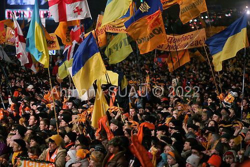 "Kiev, Ukraine.December 27, 2004..Perhaps the last ""Orange Revolution"" rally in Kiev as election polls show the opposition candidate Viktor Yushchenko in a strong lead with 98% of the vote counted. ..Thousands of supporters rally to his side on Maidan Independence Square.  ..The first round of voting was considered fraudulent when the ruling president Viktor Yahukovich won and the opposition candidate Viktor Yushchenko lost. ..Several hundred thousand Ukrainians took to the streets of Kiev and held daily rallies on Maidan Independence Square. The protests lasted nearly a month before the first vote was declared invalid and a new round of elections held on December 26, 2004. ..The demonstrations would come to be known as the ""Orange Revolution"" after the color of the opposition party."