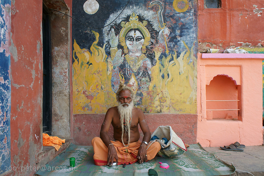 Sadhu  in Varanasi   watching  river Ganga