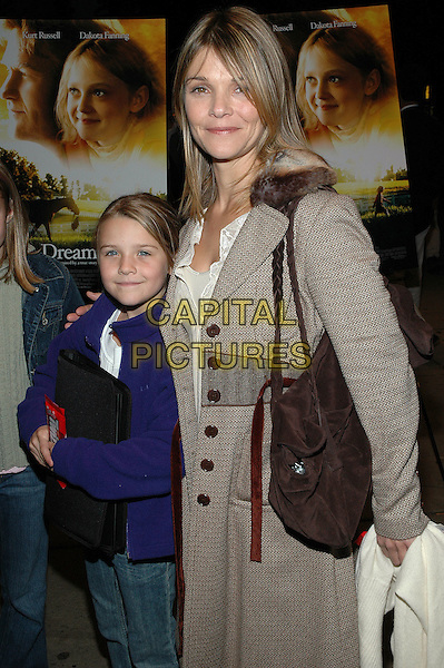 "KATHRYN ERBE & DAUGHTER MAEVE.Fathers and Daughters screening of the new film, ""Dreamer"" at the Chelsea West Theater in Manhattan.  .17 October 2005.Ref:ADM/PO.half length mother mum mummy daughter brown tweed long jacket fur trim collar braided straps shoulder bag.www.capitalpictures.com.sales@capitalpictures.com.©Patti Ouderkirk/AdMedia/Capital Pictures."