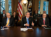 "Washington, D.C. - February 24, 2006 -- United States  President George W Bush meets with his cabinet in the Cabinet Room of the White House 23 February, 2006 in Washington, DC.  President Bush announced the release of a White House report on the response to Hurricane Katrinia.  In his remarks to the pool The President stated ""We will learn from lessons of the past to better protect the American people.""  From left to right: United States Secretary for Homeland Security Michael Chertoff, The President, and United States Secretary of Defense Donald Rumsfeld.  Also visible in the photo is Frances Fragos Townsend, Assistant to the President for Homeland Security and Counterterrorism (next to the American flag between Secretary Chertoff and The President).<br /> Credit: Brendan Smialowski - Pool via CNP"