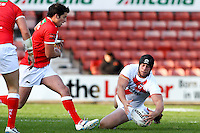 PICTURE BY ALEX WHITEHEAD/SWPIX.COM - Rugby League - Autumn International Series - Wales vs England - Glyndwr University Racecourse Stadium, Wrexham, Wales - 27/10/12 - England's Chris Hill dives on the ball.