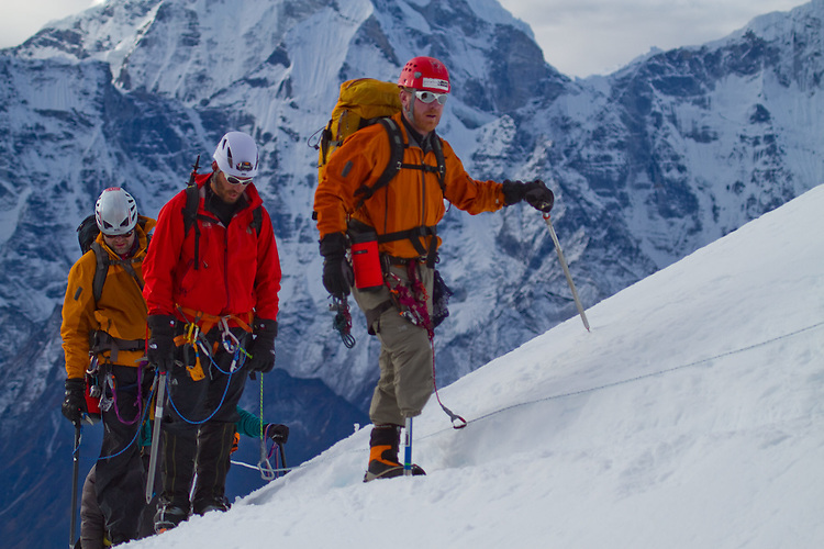 (right to left) Chad Butrick, Ike Isaacson, Matt Murray 3/4 the way up Lobuche at about 18,000 feet. Photo by Didrik Johnck.