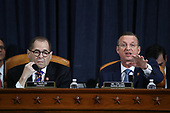 United States Representative Jerrold Nadler (Democrat of New York), Chairman, US House Judiciary Committee (L) looks on as US Representative Doug Collins (Republican of Georgia), Ranking Member, US House Judiciary Committee speaks before constitutional scholars testify before the US House Judiciary Committee in the Longworth House Office Building on Capitol Hill December 4, 2019 in Washington, DC. This is the first hearing held by the Judiciary Committee in the impeachment inquiry against U.S. President Donald Trump, whom House Democrats say held back military aid for Ukraine while demanding it investigate his political rivals. The Judiciary Committee will decide whether to draft official articles of impeachment against President Trump to be voted on by the full House of Representatives. <br /> Credit: Drew Angerer / Pool via CNP