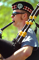 Scottish bagpiper age 38. In the Heart of the Beast May Day Festival and Parade Minneapolis Minnesota USA