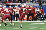 Washington State punter, Oscar Draguicevich, punts during the Cougs big Alamo Bowl victory over the Iowa State Cyclones, giving WSU a season record 11th win.