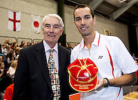 17 OCT 2009 - LOUGHBOROUGH, GBR - Nathan Robertson (right) receives his 100th cap from John Havers, President of Badminton England, ahead of the Team England v Japan International (PHOTO (C) NIGEL FARROW)