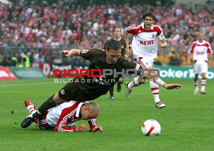 2.Liga 2007/2008  1. Spieltag Hinrunde<br /> FC St.Pauli &ndash; vs. 1.FC Koeln 0:2<br /> <br /> St.Paulis Marcel Eger (Nr.14, Mitte) wird von Koelns Nemanja Vucicevic (Nr.21, am Boden) gefoult. Torschuetze Patrick Helmes (Nr.9 im Hintergrund).<br /> <br /> <br /> Foto &copy; nph (nordphoto)<br /> <br /> *** Local Caption ***