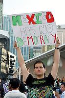 Young Mexican political protestor holding up a sign at the Mexico Fest 2012 celebrations on Sept. 8, 2012 in Vancouver, British Columbia, Canada. These celebrations commemorated 202 years of Mexican Independence.