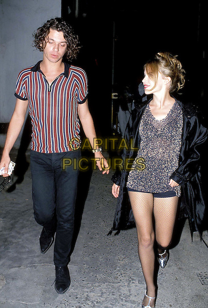 MICHAEL HUTCHENCE & KYLIE MINOGUE.Ref: 007.watch, celeb couple, deceased, dead, full length, full-length, hot pants.*RAW SCAN - photo will be adjusted for publication*.www.capitalpictures.com.sales@capitalpictures.com.© Capital Pictures