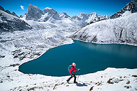 Hiking the 5356 meter Gokyo Ri in the Nepal Himalaya after a fresh snowfall. Gokyo Ri is a popular small peak with a view of Mount Everest.