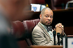 Nevada Senate Minority Leader Aaron Ford, D-Las Vegas, work on the Senate floor at the Legislative Building in Carson City, Nev., on Monday, April 20, 2015. <br /> Photo by Cathleen Allison