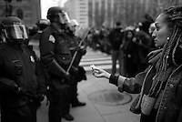A protestor offers a flower to police dressed in riot gear after scuffles between police and protestors on Inauguration Day in Washington, DC on Jan. 20, 2017.