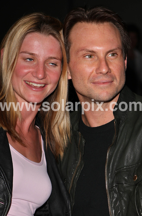 **ALL ROUND PICTURES FROM SOLARPIX.COM**.**WORLDWIDE SYNDICATION RIGHTS**.Departures - the Virgin Unite to end Fistula - Bowl off, held at the All Star Lanes bowling Alley in Queensway, Bayswater, London. Wednesday 5th September 2007...This pic: Christian Slater and fan..JOB REF: 4636 SSD     DATE: 05_09_2007.**MUST CREDIT SOLARPIX.COM OR DOUBLE FEE WILL BE CHARGED* *UNDER NO CIRCUMSTANCES IS THIS IMAGE TO BE REPRODUCED FOR ANY ONLINE EDITION WITHOUT PRIOR PERMISSION*