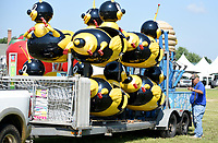 NWA Democrat-Gazette/DAVID GOTTSCHALK Ralph Mitchell, with Mitchell Brothers Amusements, directs the position Monday, August 5, 2019, of a bumble bee children's ride at St. Joseph's Catholic Church in Tontitown for the 121th Tontitown Grape Festival. The festival begins today and runs thru Saturday August 10. Homemade spaghetti will be served August 8 thru Aug. 10. For more information see tontitowngrapefestival.com.