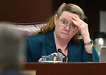 Nevada Assemblywoman Maggie Carlton, D-Las Vegas, works in committee at the Legislative Building in Carson City, Nev., on Tuesday, March 3, 2015. <br /> Photo by Cathleen Allison