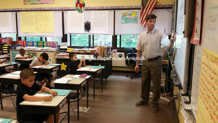 WATERBURY -- Regan Elementary School third grade teacher Kevin Mitchell leads a math lesson Friday.