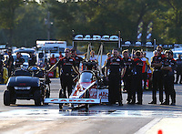 Aug 15, 2014; Brainerd, MN, USA; Crew members with NHRA top fuel dragster driver Steve Torrence during qualifying for the Lucas Oil Nationals at Brainerd International Raceway. Mandatory Credit: Mark J. Rebilas-