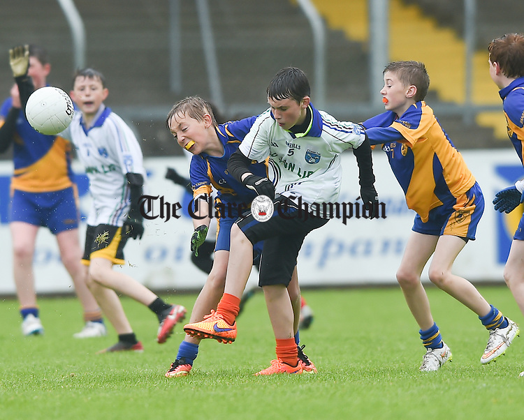Diarmuid Connelly of Clann Lir is tackled by The Banner's Matthew Mc Grath and Conor Dennehy during the U-12 football finals in Cusack park. Photograph by John Kelly.