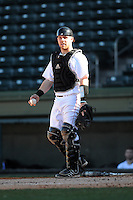Catcher Woody Wallace (10) of the Cincinnati Bearcats in a game against the Western Carolina Catamounts on Sunday, February 24, 2013, at Fluor Field in Greenville, South Carolina. Cincinnati won in 10 innings, 7-6. (Tom Priddy/Four Seam Images)