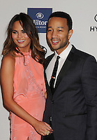 BEVERLY HILLS, CA - FEBRUARY 09: Chrissy Teigen and John Legend arrive at the The 55th Annual GRAMMY Awards - Pre-GRAMMY Gala And Salute To Industry Icons Honoring L.A. Reid at the Beverly Hilton Hotel on February 9, 2013 in Beverly Hills, California.PAP0213JP405.PAP0213JP405. Nortephoto