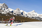 Canadian biathlon athlete Nathan Smith rounds a turn at The International Biathlon Union Cup # 7 Men's 10 KM Sprint held at the Canmore Nordic Center in Canmore Alberta, Canada, on Feb 16, 2012.  Nathan goes on to win this race, his third win of three sprints held in Canmore.  Two sprints were held the previous weekend in Cup 6.  Photo by Gus Curtis.