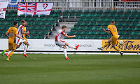 Asa Hall of Cheltenham scores his side's first goal under pressure from Scott Bennett of Newport County during the Sky Bet League 2 match between Newport County and Cheltenham Town at Rodney Parade, Newport, Wales on 10 September 2016. Photo by Mark  Hawkins / PRiME Media Images.