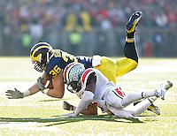 Ohio State Buckeyes cornerback Bradley Roby (1) takes down  (36)***Michigan Wolverines fullback Joe Kerridge (36) at Michigan Stadium in Ann Arbor, Michigan on November 30, 2013.  (Chris Russell/Dispatch Photo)