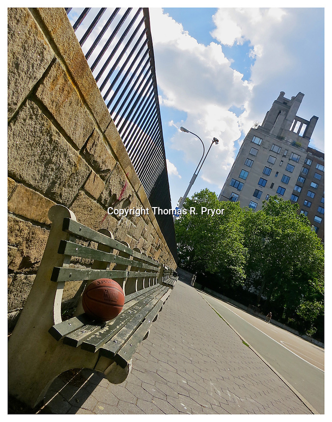 NEW YORK, NY - JULY 2: Basketball on a park bench outside of Carl Schurz Park's hockey field in Yorkville, New York on July 2, 2012. Photo Credit: Thomas R Pryor