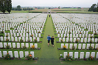 Visitors walk through Tyne Cot Cemetery for the dead of World War I in Ypres Salient, West Flanders, Belgium, August 28, 2014. The Commonwealth cemetery has about 12,000 tombstones and a wall containing the names of 35,000 soldiers missing in action. 2014 marks 100th anniversary of the Great War.