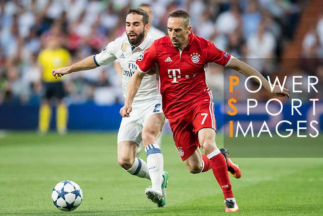 Franck Ribery (r) of FC Bayern Munich fights for the ball with Daniel Carvajal Ramos of Real Madrid during their 2016-17 UEFA Champions League Quarter-finals second leg match between Real Madrid and FC Bayern Munich at the Estadio Santiago Bernabeu on 18 April 2017 in Madrid, Spain. Photo by Diego Gonzalez Souto / Power Sport Images