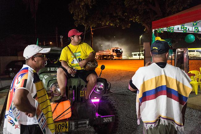 Cesar Porras, John Jairo  Zapata y  Ramon n Cort&eacute;z descansan , Cesar Porras  se detienen en un parador de la carretera de Brasilia a Cuiaba en su largo trayecto acompa&ntilde;ando a la Seleccion Colombia durante el mundial de Brasil el 20 de junio de 2014.<br /> John Jairo es revendedor de carros y se enamor&oacute; del Willis pertenecia antiguamente al ejercito  de EEUU ni bien lo vi&oacute; y lo reconstruy&oacute; totalmente. A lo largo de dos meses cumple su sue&ntilde;o de acompa&ntilde;ar a la Seleccion Colombia en el mundial de Brasil, viajando miles de kilometros a una marcha promedio de 60 KM por hora, durmiendo en alojamientos economicos y compartiendo gastos con eventuales hinchas que se han ido sumando a la Expedicion Jipao, como el la ha bautizado.<br /> <br />   Lorenzo Moscia/Archivolatino<br /> <br /> lCOPYRIGHT: Archivolatino<br /> Solo para uso editorial, prohibida su venta y su uso comercial